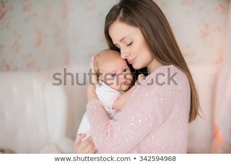 Smiling mother holding baby Stock photo © IS2