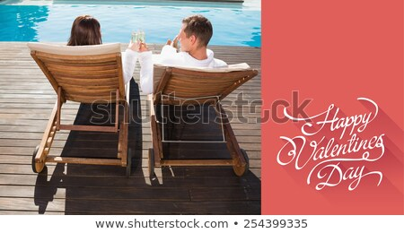 Couple drinking wine and relaxing on lounger Stock photo © IS2