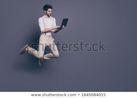 Serious businessman flies, sales Stock photo © studiostoks