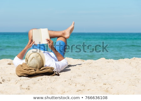 man reading a book on the beach stock photo © nito
