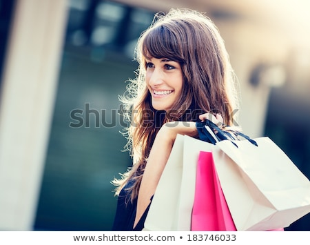 Beautiful happy blond woman shopping bag at the mall 