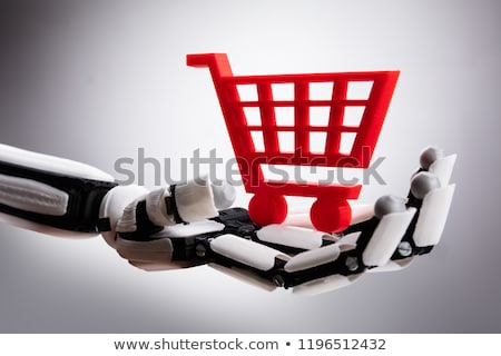 Robot Holding Red Shopping Cart Stock photo © AndreyPopov