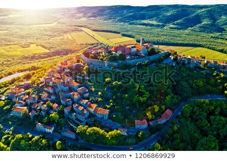 hill town of motovun at sunset aerial view stock photo © xbrchx