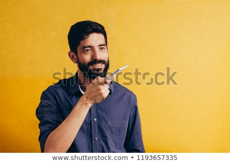 Man Using Voice Assistant On Cellphone Stock photo © AndreyPopov