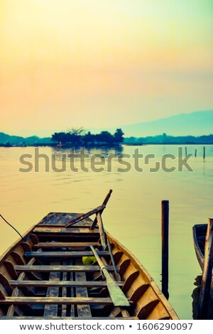 fisherman on the jetty in early morning light stock photo © lovleah