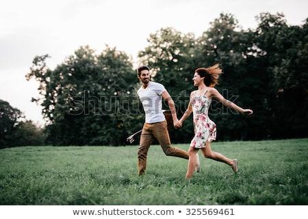 amantes · mantener · manos · caminata · parque · puesta · de · sol - foto stock © ruslanshramko