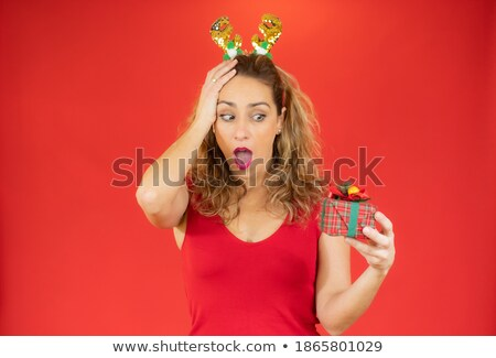 Pensive young girl wearing red santa hat standing Stock photo © deandrobot