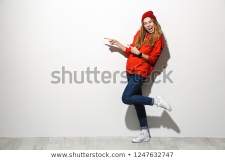 full length photo of adorable woman 20s wearing red clothes laug stock photo © deandrobot