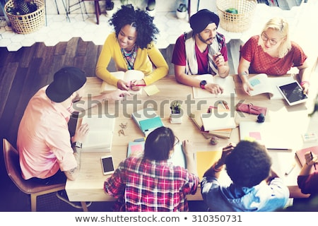 Team of people work together in office with a tablet. Concept of teamwork and partnership. Double ex Stock photo © alphaspirit