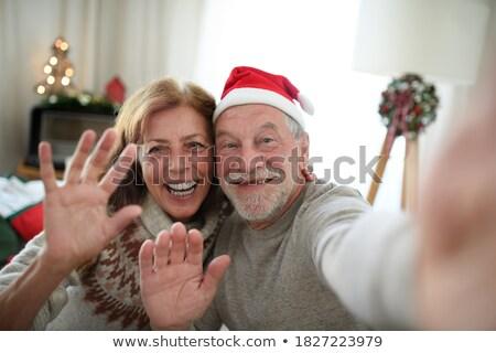 女性 · サンタクロース · 帽子 · スマートフォン · 人 - ストックフォト © dolgachov