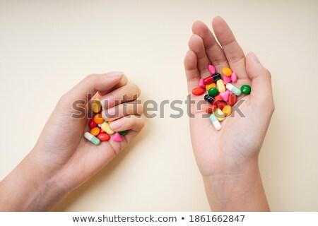 Színes kéz tabletták kicsi műanyag táska Stock fotó © ra2studio
