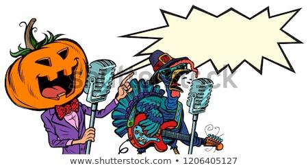 thanksgiving and halloween music festival pumpkin and turkey stock photo © rogistok