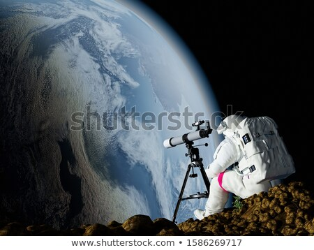 the astronaut looks at the globe stock photo © conceptcafe