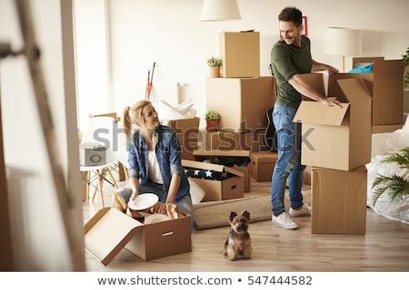 Férfi költözés dobozok otthon táska növény Stock fotó © Elnur