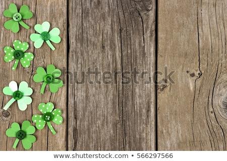 Zöld papír shamrock fából készült szerencse Szent Patrik napja Stock fotó © dolgachov