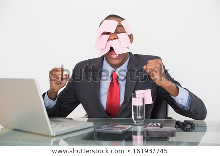 Frustrated businessman covered by blank post-it notes. stock photo © lichtmeister