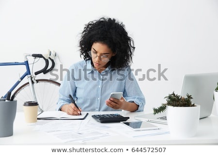 Female freelancer making notes at home Stock photo © dashapetrenko