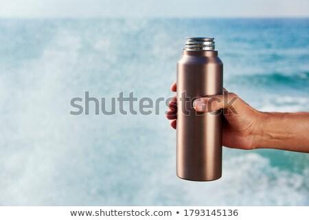 aluminum reusable water bottle on the beach Stock photo © nito