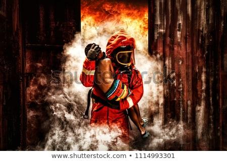 Bombeiro resgatar criança ardente edifício menina Foto stock © vichie81