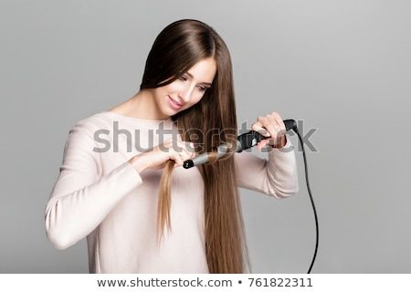 Stock photo: woman curling hair