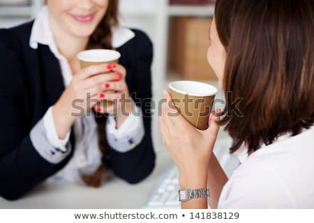 Woman sitting in office with coffee cup Stock photo © photography33