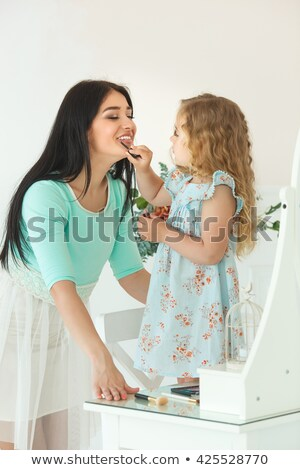 Girl Applying Lipstick To Her Lips Stock photo © stuartmiles
