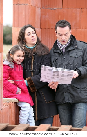 parents and daughter visiting site of new house stock photo © photography33