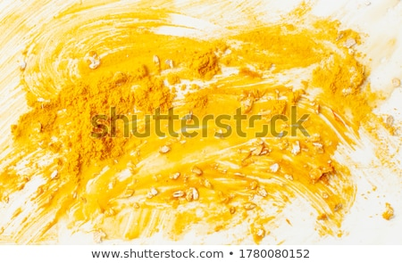 Yellow Texture made from turmeric  Stock photo © ziprashantzi