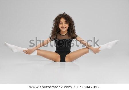 sporty girl in black leotard Stock photo © dolgachov