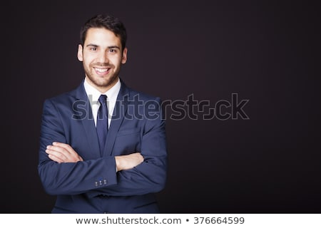 Handsome man in a business suit on a dark background Stock photo © konradbak