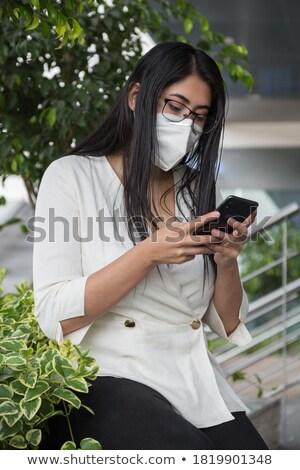 Csinos diák telefon fehér boldog áll Stock fotó © wavebreak_media