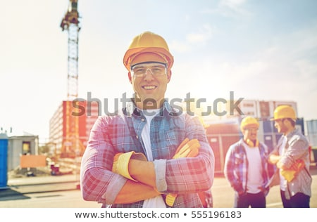 Young construction worker smiling Stock photo © elenaphoto
