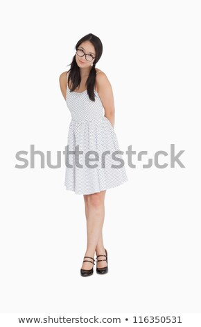 smiling woman in pigtails and polka dot dress and glasses stock photo © wavebreak_media