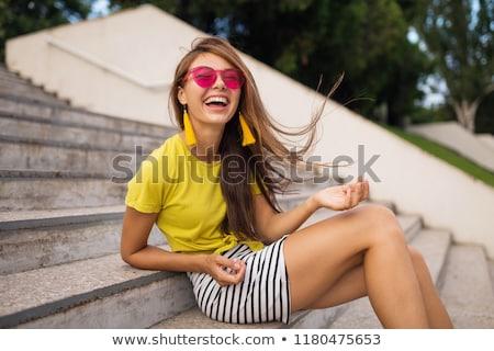 Gyönyörű lány miniszoknya fiatal csinos nő fehér felső Stock fotó © Aikon