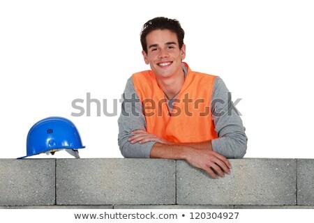 Young mason stood by wall Stock photo © photography33