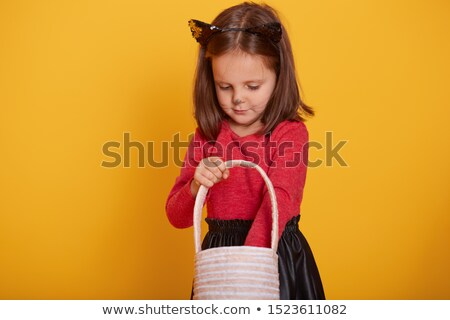 Beautiful young girl wearing red roses dress posing on black bac Stock photo © Victoria_Andreas