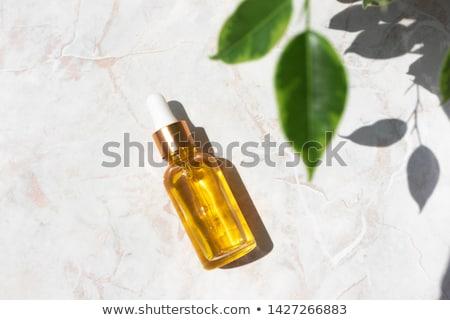 Garrafa corpo Óleo folhas fresco folhas verdes Foto stock © taden