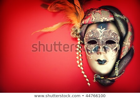 Carnival Mask And A Red Christmas Ball On A Golden Abstract Back Foto stock © HannaMonika