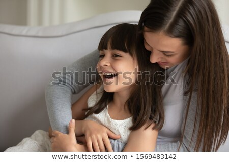 Cute girl tickling her younger sister Stock photo © konradbak