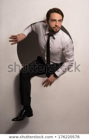 zakenman · klimmen · uit · gat · knap - stockfoto © stryjek