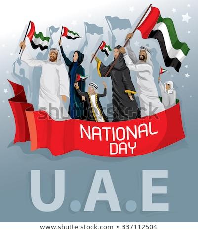 United Arab Emirates flag. Man holding banner with UAE Flag. Stock photo © stevanovicigor