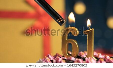 Burning birthday candles number 61 Stock photo © Zerbor
