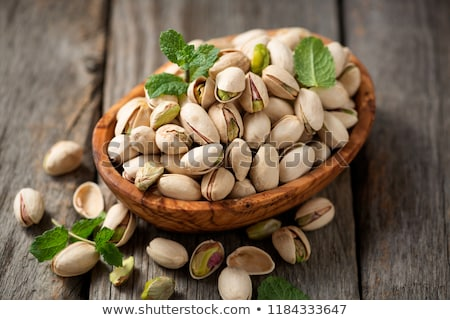 Pistachio nuts in a bowl Stock photo © raphotos