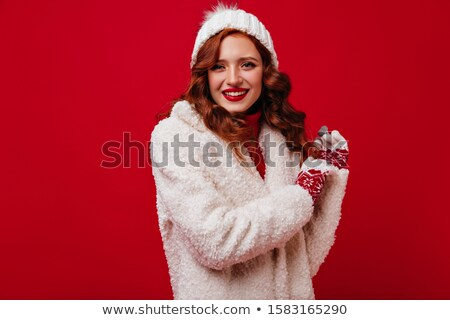 Girl smiling in fur hat and coat stock photo © Kor
