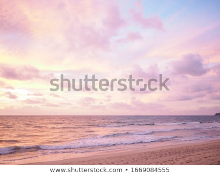 Pink sunset on a cloudy evening Stock photo © smithore