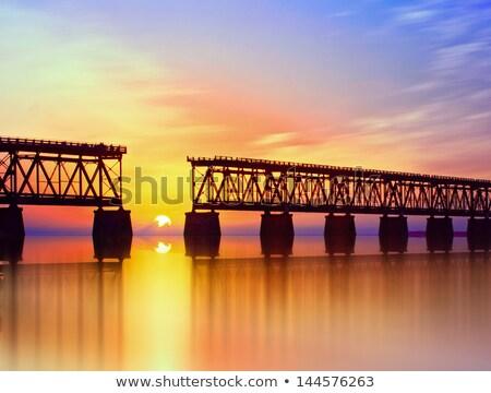 Stock photo: Sunset with famous broken bridge
