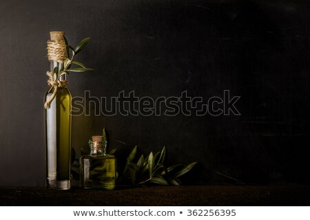 glass jar with olive oil rustic background stock photo © marimorena