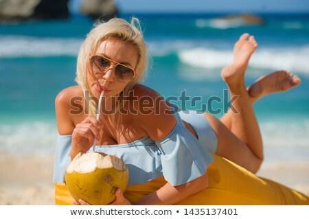 Rubio mujer relajante hamaca blanco Foto stock © dash