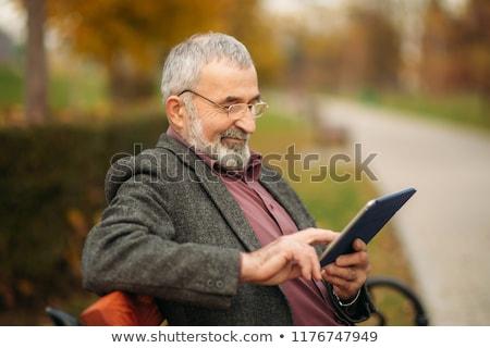 Nagyapa gyermek park tabletta táblagép szeretet Stock fotó © dotshock