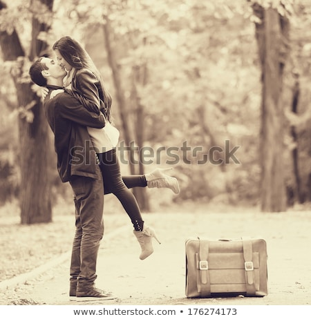 pashionate photo of a kissing young couple stock photo © deandrobot